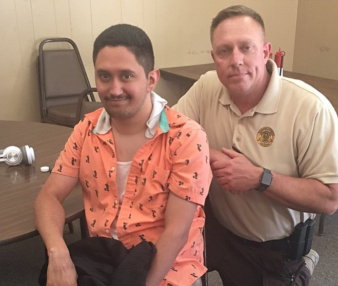 "Local law enforcement were assisted by search-and-rescue volunteers in locating Alonso ""Israel"" Salazar,  left, who went missing from Emmanuel Pines Camp Sunday evening, June 3. He was found mid-day Tuesday, June 5. Alonso is pictured with Search Commander Sgt. Brent Kimbriel after his return. (Courtesy)"