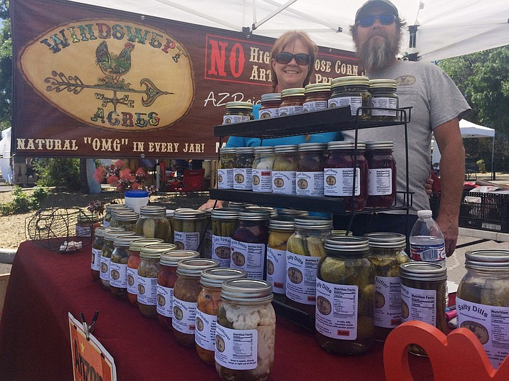 Pam Baker and Dave Harris of Windswept Acres at the Prescott Farmers Market Saturday, June 2. They'll be selling at the Chino Valley Farmers Market which starts its 11th year Thursday, June 7. (Jason Wheeler/Review)