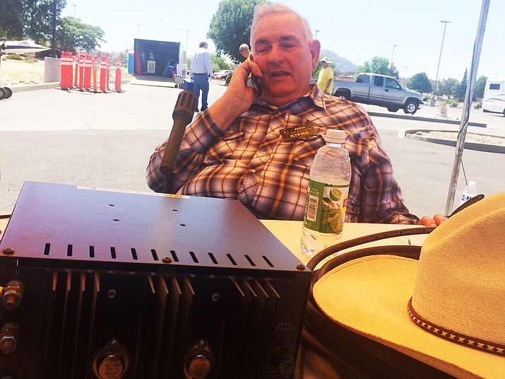John Laine, also known as K7PRS of the Yavapai Amateur Radio Club, makes contact on a ham radio at the Prescott HAMFest Saturday, June 2, 2018. (Jason Wheeler/Courier)