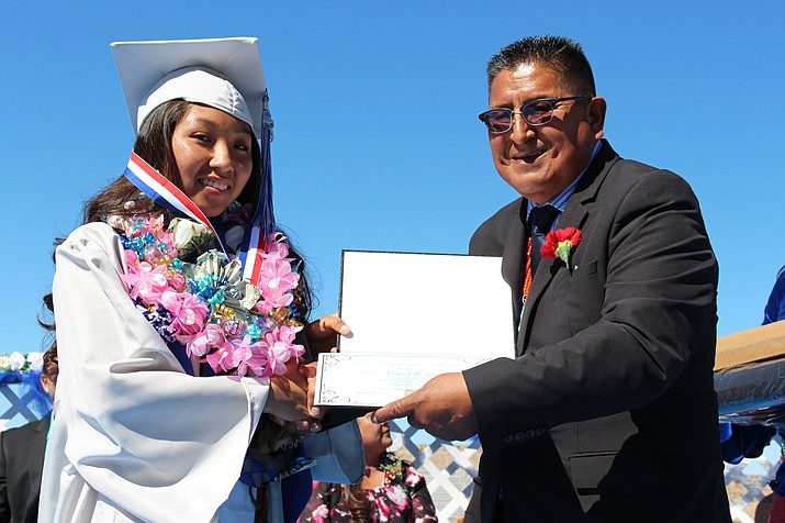 Traci Nahsonhoya receives her co-salutatorian award from Hopi Vice Chairman Clark Tenakhongva. (Stan Bindell/NHO)