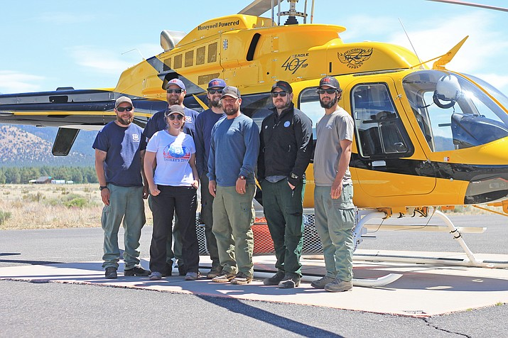 Pittman Valley Helitack crew on Kaibab National Forest has already responded to several wildfires this season. The crew includes Cole Orozco, Bradley Castle, Grayson Beckley, Ernie Tilley, Jacob Maldonado, Nick Paris, Anne Paya and Neil Schalk (not pictured).  (Wendy Howell/WGCN)