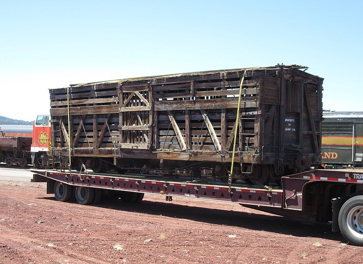 Two vintage narrow gauge railroad cars arrived from the D&RG Railway Historical Foundation in Monte Vista, Colorado to Williams via truck May 23. The cars are currently located on the future site of the park on Roundhouse Road. These cars are the second and third pieces of equipment that will help the park to interpret the story of Arizona's narrow gauge railroads. The stock car requires some roof repairs and will be restored with a coat of black paint. The boxcar does not require much restoration and will receive a coat of mineral brown paint. Grand Canyon Railway personnel assisted with the offload. (Photo/Al Richmond)