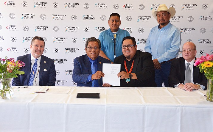 Navajo Gaming Enterprise and Navajo Nation Council delegates and president finalize loan documents for the Twin Arrows Travel Center. (Submitted photo)