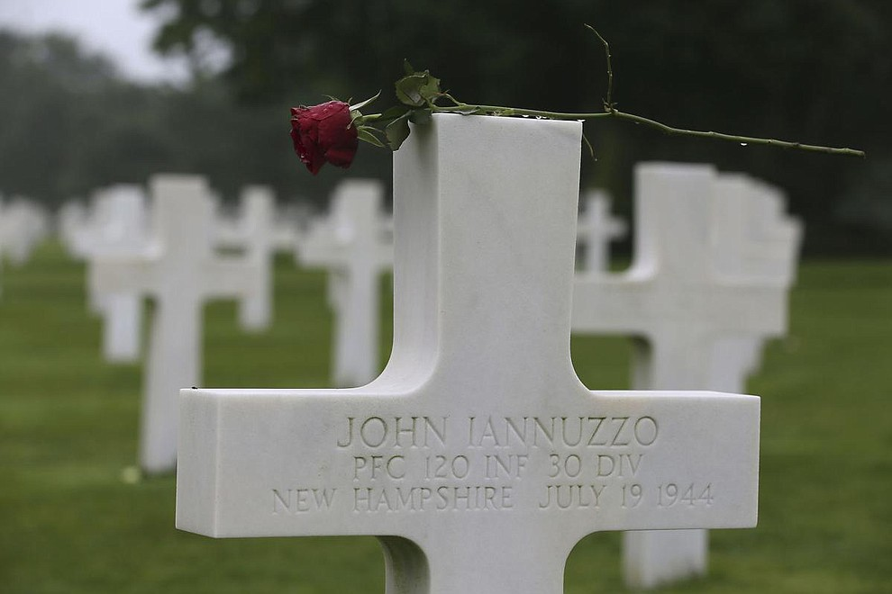 A red rose is placed on the headstone of John Iannuzzo, from New Hampshire 120th Infantry 30th division, at the Colleville American military cemetery, in Colleville sur Mer, western France, Wednesday June 6, 2018, on the 74th anniversary of the D-Day landing. U.S. and other allied troops have joined veterans of the D-Day invasion and families of fallen soldiers to mark 74 years since the massive military operation that change the course of World War II. (AP Photo/David Vincent)