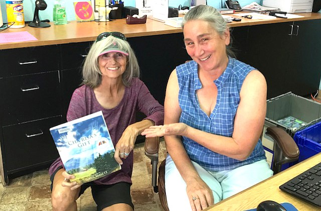 Ilana Maletz, library volunteer and author, shares the book she wrote with Dee Chadwick.