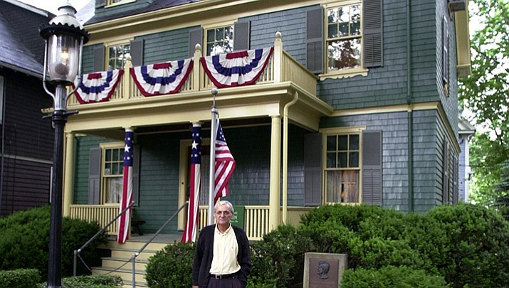 In this June 19, 2002 file photograph Leonor Suarez, of Brookline, Mass., left, takes a photograph of her brother, Joes Luis Suarez, of Almeria, Spain, in Brookline, in front of the family home of President John F. Kennedy and U.S. Sen. Robert F. Kennedy, D-NY. The suburban Boston house where Robert F. Kennedy was born, now a national historic site in tribute to his more famous brother, President John F. Kennedy, is holding a special exhibition to mark the 50th anniversary of RFK's assassination on June 6, 1968. (AP Photo/Steven Senne)