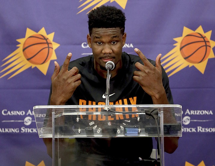 NBA Draft prospect Deandre Ayton, who may be the Phoenix Suns' choice with the No. 1 overall pick in this month's NBA draft, talks to the media after an individual workout with the Suns, Wednesday, June 6, 2018 in Phoenix. (Matt York/AP)