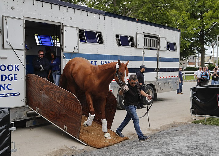 Kentucky Derby and Preakness Stakes winner Justify is led off the trailer upon arriving at Belmont Park, Wednesday, June 6, 2018, in Elmont, N.Y. Justify will attempt to become the 13th Triple Crown winner when he races in the 150th running of the Belmont Stakes horse race on Saturday. (Julie Jacobson/AP)