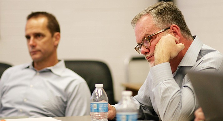 Mingus Union School Board members Jim Ledbetter and Steve Gesell listen to discussions during the board's special meeting Wednesday. (Photo by Bill Helm)