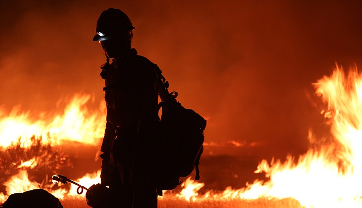 """Federal officials said they still expect a """"challenging"""" wildfire season in 2018, particularly in drought-ravaged areas of the Southwest. That comes on the heels o a year, 2017, in which the government spent a record $2.9 billion fighting wildfires. (Photo by Tim Mason/U.S. Forest Service)"""