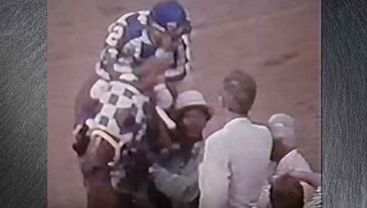 Secretariat was a 1-10 favorite during the 1973 Belmont Stakes. The chestnut colt finished the race in 2:24, which is still a record time today. (Screen capture via CBS video)