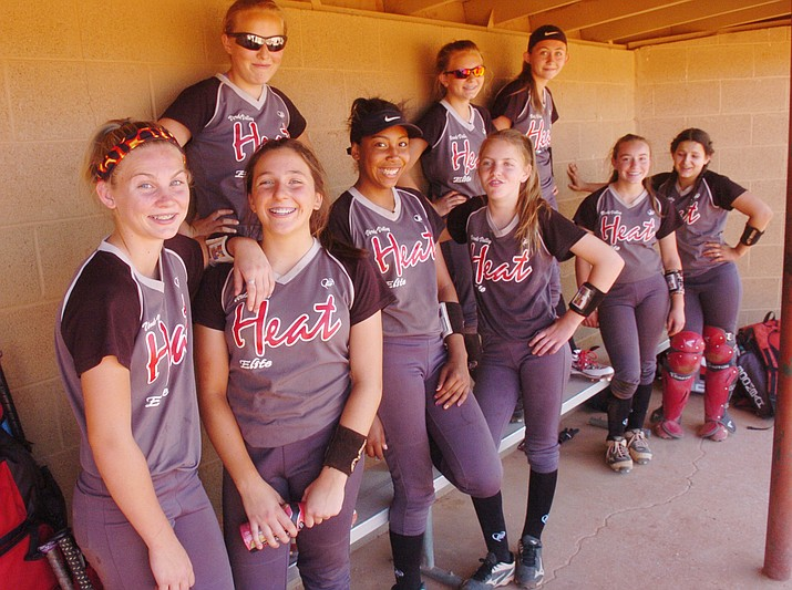 Verde Valley Heat Elite 14U's gather on the bench before a game at the Schools Out for Summer NSA fastpitch girls softball tournament at Pioneer Park in Prescott Saturday, June 2, 2018. (Les Stukenberg/Courier)
