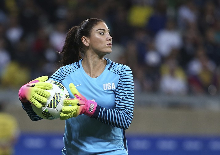 In this Aug. 3, 2016, file photo, United States' goalkeeper Hope Solo takes the ball during a women's soccer game at the Rio Olympics against New Zealand in Belo Horizonte, Brazil. By choosing to actively campaign against the U.S.-led North America bid on the 2026 World Cup host, Solo risks alienating herself further from the soccer community in her homeland. The bid leadership reacted furiously when informed Solo was undermining their efforts heading into the vote on Wednesday June 7, 2018, dismissing her criticism of the governance of soccer in the country as wild and unwarranted. (Eugenio Savio/AP, File)