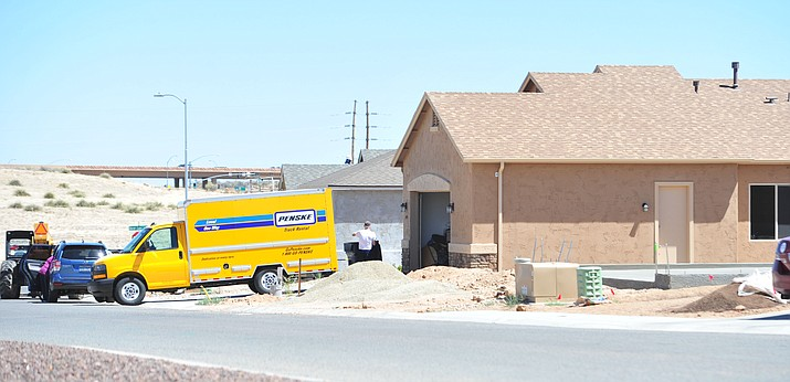 Moving vans and construction crews mix as construction on new homes is booming in the new section of Granville in Prescott Valley. (Les Stukenberg/Courier)