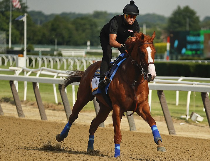 Triple Crown hopeful Justify gallops around the main track during a workout at Belmont Park, Friday, June 8, 2018, in Elmont, N.Y. Justify will attempt to become the 13th Triple Crown winner Saturday. (Julie Jacobson/AP)