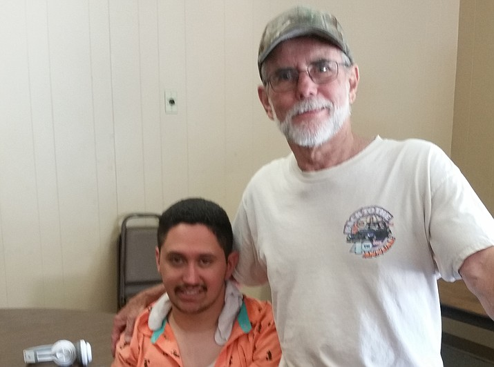 "Alonso ""Israel"" Salazar, a man who went missing in the Prescott area Sunday evening, June 3, sits with Michael Byrd, the man who found him, mid-day Tuesday, June 5. (Courtesy)"