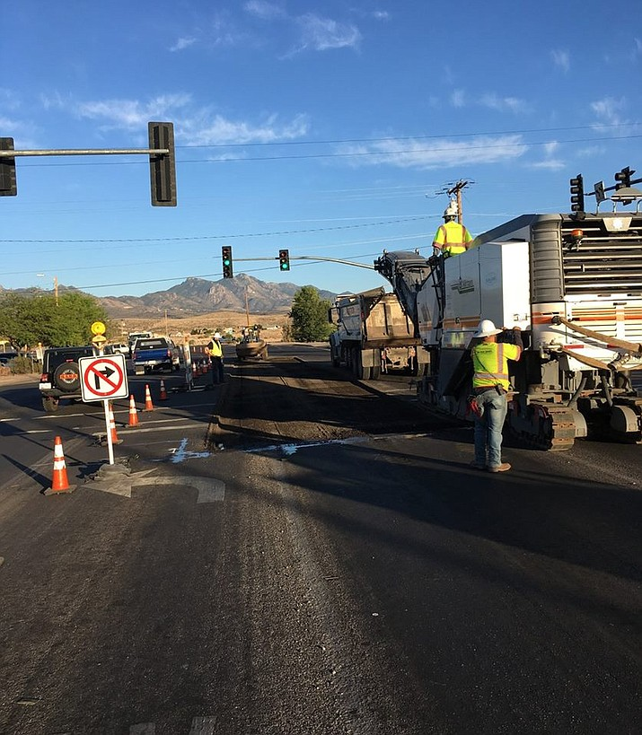 City of Kingman workers at the intersection of Stockton Hill Road, Hualapai Mountain Road and Andy Devine Avenue replacing asphalt last week. Work will continue in the area overnight Monday and Tuesday. (Photo courtesy of City of Kingman Public Works)