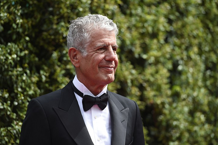 In this Saturday, Sept. 12, 2015 file photo, Anthony Bourdain arrives at the Creative Arts Emmy Awards in Los Angeles. On Friday, June 8, 2018, Bourdain was found dead in his hotel room in France, while working on his CNN series on culinary traditions around the world. (Photo by Chris Pizzello/Invision/AP)