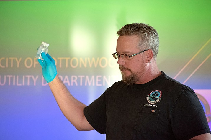 Utilities Operation Manager Mike Traynor demonstrated to the public how easy a sample can be contaminated if proper protocol isn't followed. (VVN/Halie Chavez)