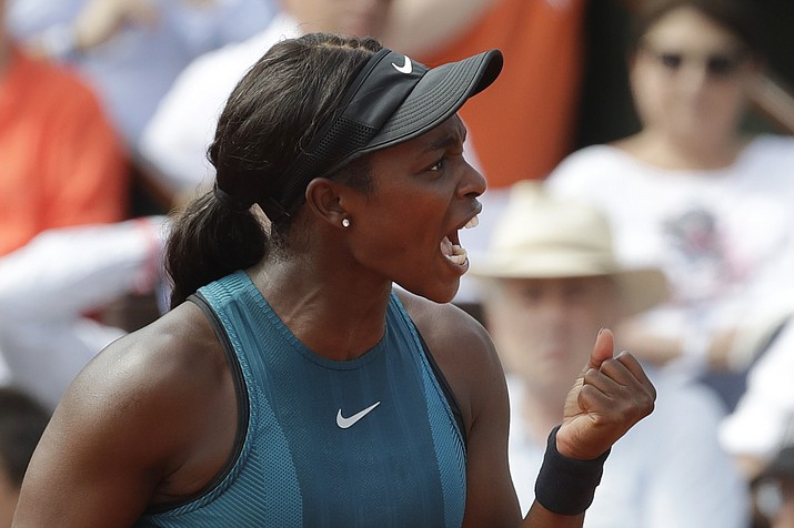 Sloane Stephens of the U.S. clenches her fist after scoring a point against Romania's Simona Halep in the final match of the French Open tennis tournament at the Roland Garros stadium in Paris, France, Saturday, June 9, 2018. (AP Photo/Alessandra Tarantino)