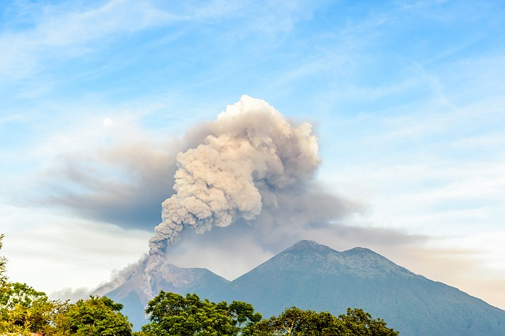 "The Volcan de Fuego or ""Volcano of Fire"" continues to spew huge clouds of ash, in San Miguel Los Lotes, Guatemala, Friday. (Adobe Images)"