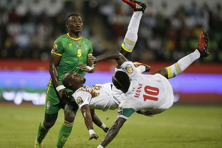 Senegal's Moussa Sow, center, and teammate Sadio Mane, right, in action with Zimbabwe's Elisha Muroiwa, left, during the African Cup of Nations Group B soccer match between Senegal and Zimbabwe at Stade de Franceville Stadium in Franceville, Gabon. Mane, who left a rural village in southern Senegal as a teenager to find international stardom in Europe, hopes to defy the odds again at the World Cup in Russia. (AP Photo/Sunday Alamba, File)
