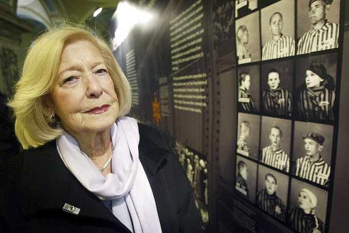 In this Jan. 27, 2004 file photo, Holcaust survivor Gena Turgel poses for a photo, in London. Turgel, a Holocaust survivor who comforted diarist Anne Frank at the Bergen-Belsen concentration camp months before its liberation, has died. She was 95. (Paul Faith/PA via AP, File)