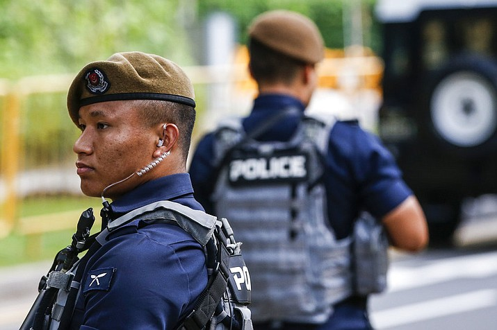 Gurkha police officers guard the perimeter of the Shangri-La Hotel in Singapore, Sunday, June 10, 2018, ahead of the summit between U.S. President Donald Trump and North Korean leader Kim Jong Un. (AP Photo/Yong Teck Lim)
