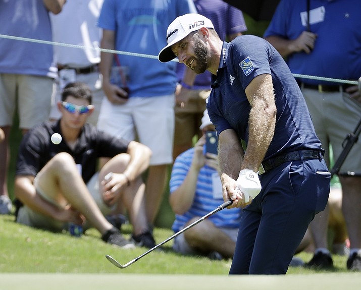 Dustin Johnson chips onto the No. 5 green during the final round of the St. Jude Classic golf tournament Sunday, June 10, 2018, in Memphis, Tenn. Johnson took a bogey on the hole. (Mark Humphrey/AP Photo