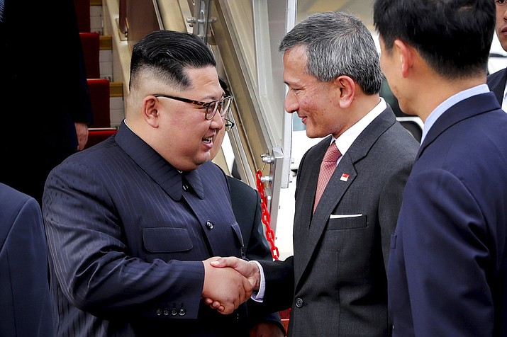 Pictured is North Korean leader Kim Jong Un, left, being greeted by Singapore Minister for Foreign Affairs Dr. Vivian Balakrishnan at the Changi International Airport, Sunday, June 10, 2018, in Singapore, ahead of a summit with U.S. President Donald Trump. (Ministry of Communications and Information Singapore)
