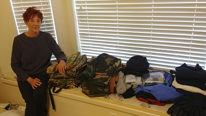 Gwen Gillman shows some of the items she donated to the Arizona Elk Society's Camo Closet program.
