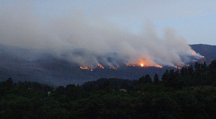 In this photo from Tuesday evening, June 18, 2002, smoke drifts from the Missionary Ridge Fire in the San Juan National Forest near Durango, Colorado. Now, as the American Southwest struggles with severe drought, national forests and parks in Arizona and New Mexico have been shut down as a precaution against wildfires. San Juan National Forest officials in southwestern Colorado are planning to close hundreds of miles of trails and thousands of miles of back roads to hikers, bikers, horseback riders and campers as early as Tuesday, June 12, 2018, to prevent the possibility of an abandoned campfire or any other spark from starting a wildfire. (Nathan Bilow, AP, file)