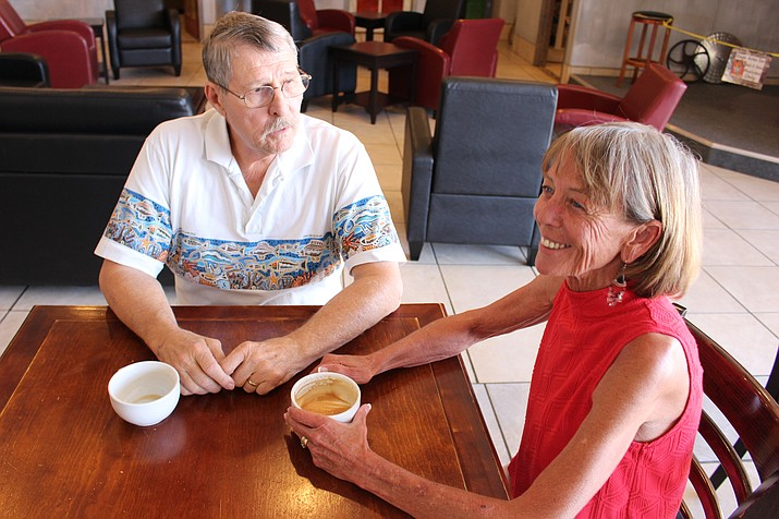 Mary McCord Robinson, Democratic candidate for state House of Representatives, talks about the issues with Danny Baker, treasurer of Mohave County Democratic Party, at Beale Street Brews coffee shop Monday. (Hubble Ray Smith/Daily Miner)