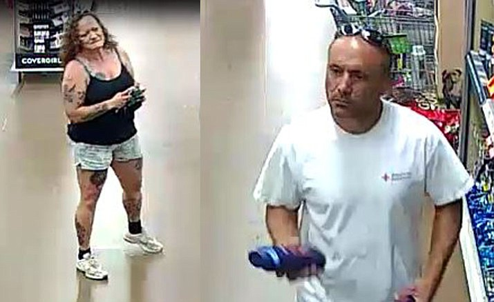 The female and male subjects who are persons of interest regarding a missing suitcase containing $170,000 that was taken from a Kingman Walmart store on Tuesday, June 5, 2018. (Kingman Police Department)