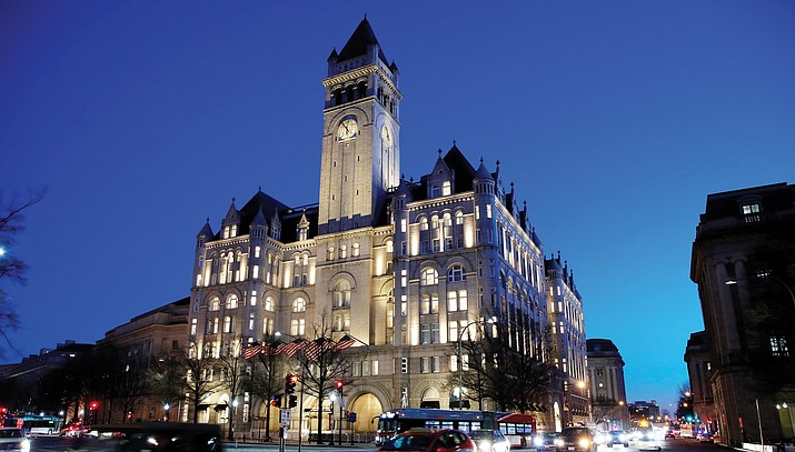 The Trump International Hotel in Washington on Jan. 30, 2018. President Donald Trump's hotel company did not break the law by doing business with other countries, a U.S. Justice Department lawyer told a federal judge Monday, June 11. The state of Maryland and the District Columbia have accused Trump of capitalizing on the presidency and causing harm to local businesses that compete with his Washington hotel. (AP Photo/Alex Brandon, file)