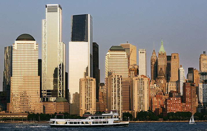 A tour boat on the Hudson River passes 3 World Trade Center, second from left, and the lower Manhattan skyline on June 7, 2018. The 80-story office building, which is set to open this week, will be the third completed skyscraper at the trade center site. (Mark Lennihan/AP Photo)