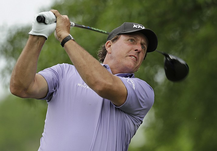 This May 5, 2018, file photo shows Phil Mickelson watching his tee shot on the second hole during the third round of the Wells Fargo Championship golf tournament at Quail Hollow Club in Charlotte, N.C. Mickelson needs the U.S. Open to complete the Grand Slam, and this is his fourth attempt. He could easily have won U.S. Opens twice at Shinnecock. In 2004, he lost to Retief Goosen and one of the great putting performances in a major. In 1995, he played the par-5 16th hole in 6 over for the week and finished four behind. (Chuck Burton/AP, File)