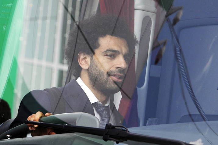 Egyptian national soccer team player and Liverpool's star striker Mohammed Salah enters a bus after arriving with the Egypt national soccer team at an airport outside Grozny, Russia, Sunday, June 10, 2018 to compete in the 2018 World Cup in Russia. The 21st World Cup begins on Thursday, June 14, 2018, when host Russia takes on Saudi Arabia. (Musa Sadulayev/AP)