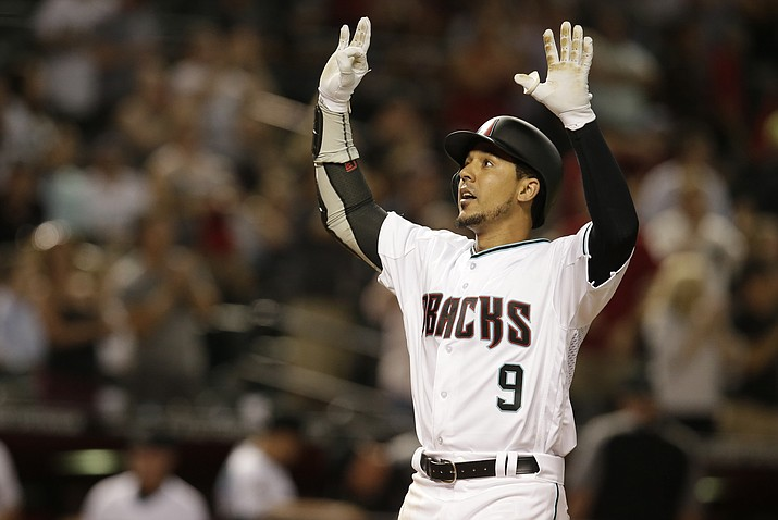 Arizona Diamondbacks' Jon Jay reacts after hitting a three-run home run against the Pittsburgh Pirates during the seventh inning of a baseball game, Tuesday, June 12, 2018, in Phoenix. (AP Photo/Rick Scuteri)