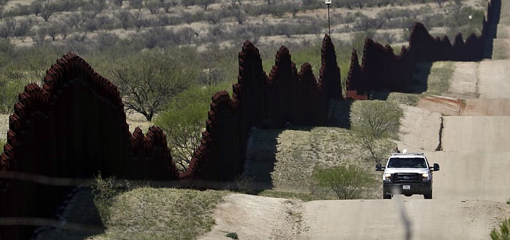 In this April 10, 2018, file photo, a Customs and Border Patrol agent patrols the international border near Nogales, Ariz. The U.S. Border Patrol says an agent has been wounded in a shooting in southern Arizona near the U.S.-Mexico border. (Matt York/AP Photo)