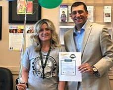 Coyote Springs Elementary School Principal Candice Blakely-Stump, left, and Dan Streeter, superintendent of Humboldt Unified School District, pose with the Yavapai Healthy School award April 16 received for promoting students' health and well-being through the Wildlife Habitat. (YC Community Health/Courtesy)