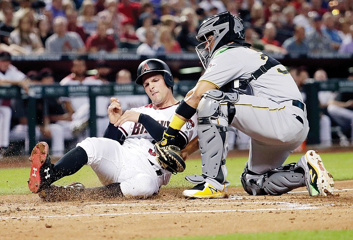 Arizona Diamondbacks' John Ryan Murphy is tagged out by Pittsburgh Pirates catcher Elias Diaz while trying to score during the second inning of a baseball game, Monday, June 11, 2018, in Phoenix. (Matt York/AP)