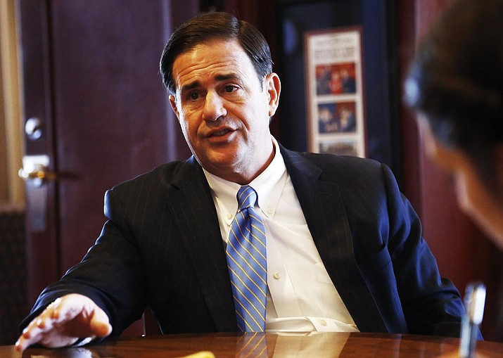 In this file photo Republican Gov. Doug Ducey speaks about a variety of issues during an interview in his office at the Arizona Capitol Tuesday, May 8, 2018, in Phoenix. (AP Photo/Ross D. Franklin)