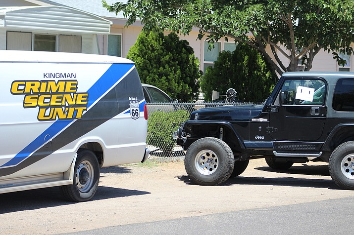 Two people were detained for questioning about cash lost at Walmart, and police drove this black jeep away. (Photo by Beau Bearden/Daily Miner)