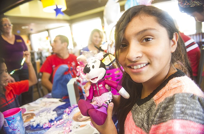 Ana Gutierrez, finds out at the Prescott Denny's Restaurant, Sunday, June 10, 2018, that she and her family received a trip to Disneyland made possible through the Make-A-Wish Foundation with contributions from Denny's. (Courtesy photo)