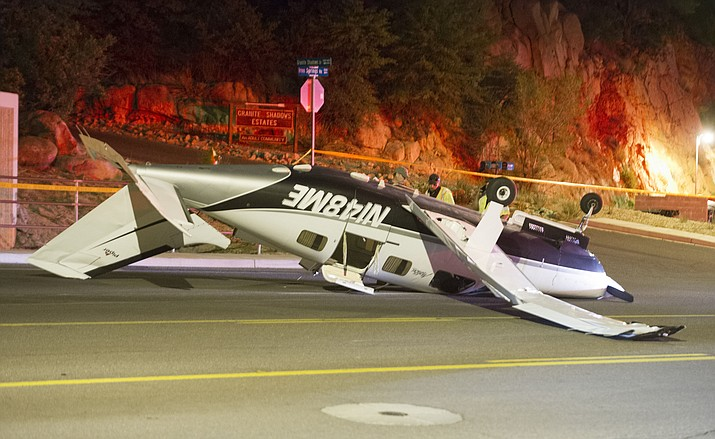 A Piper Malibu, six-seater aircraft crash landed in the 1500 block of Iron Springs Road in Prescott Tuesday, May 29, 2018, at about 9:12 p.m. The three people on board the aircraft escaped with minor injuries and were taken to Yavpai Regional Medical Center to be evaluated. (Les Stukenberg/Courier)