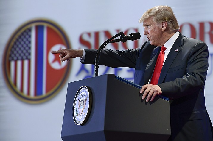 U.S. President Donald Trump answers questions about the summit with North Korea leader Kim Jong Un during a press conference at the Capella resort on Sentosa Island Tuesday, June 12, 2018 in Singapore. (AP Photo/Susan Walsh)