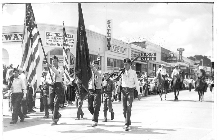 People march in a parade in downtown Williams around 1940.