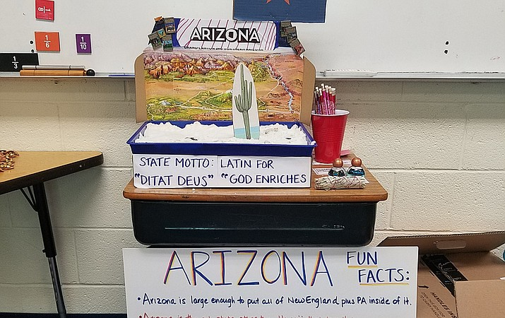 Students from Langley School in McLean, Virginia display a variety of items representing the state of Arizona that were sent to the third-grade class from residents around Arizona, including the Grand Canyon. (Submitted photo)