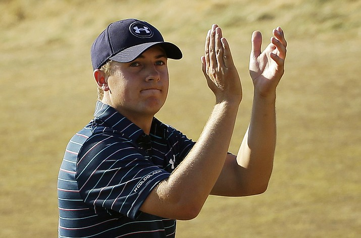 In this June 21, 2015, file photo, Jordan Spieth claps after finishing the final round of the U.S. Open in University Place, Wash. (Ted S. Warren/AP, File)